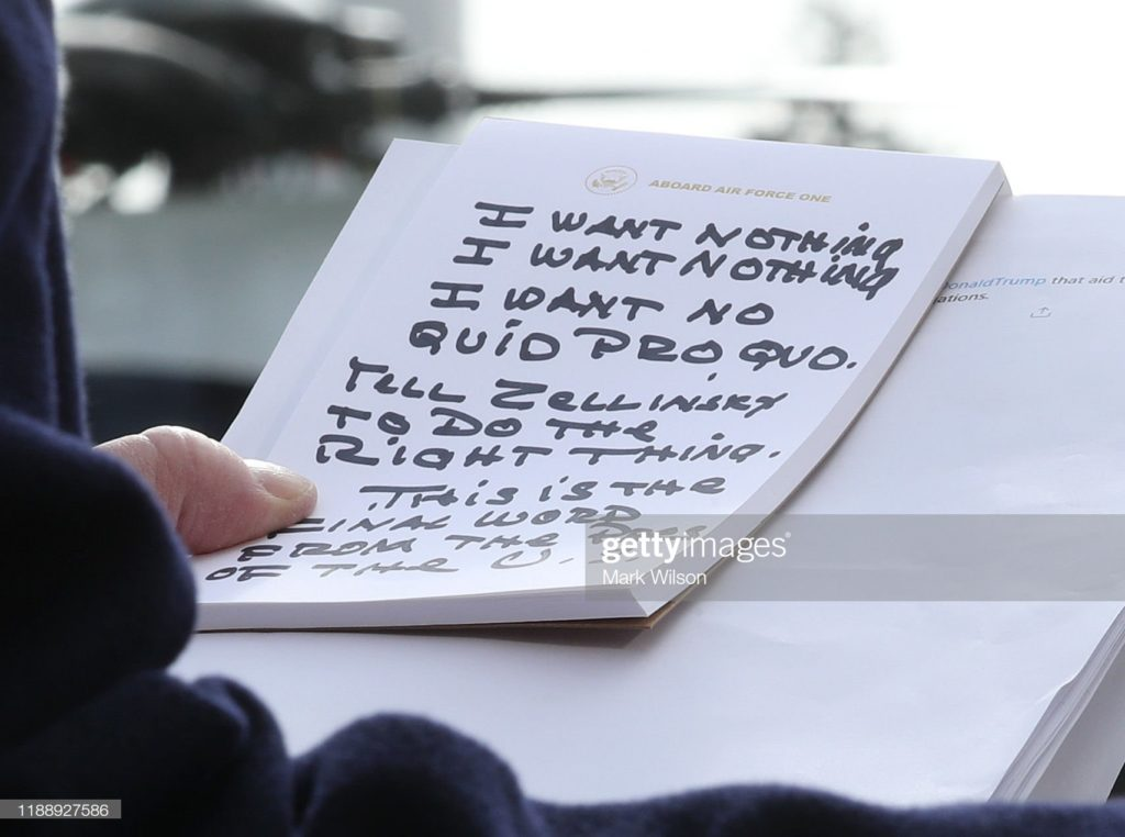 Photo (by Mark Wilson) of President Trump holding notes while speaking to the media